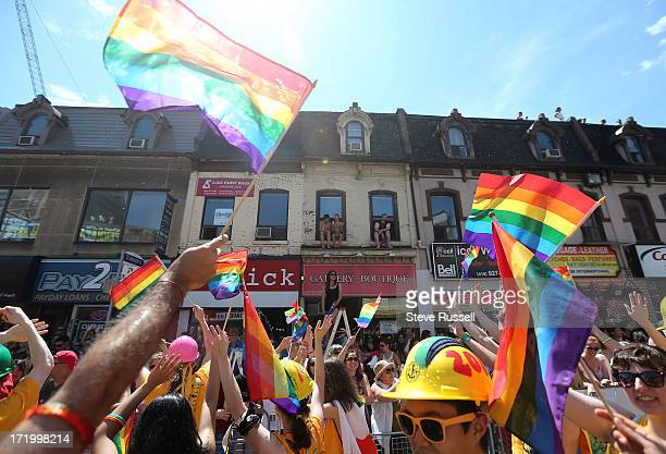 TORONTO ON JUNE 30 As marchers make their way down Yonge Street many watch from their windows in the Toronto Gay Pride Parade which attracts a...