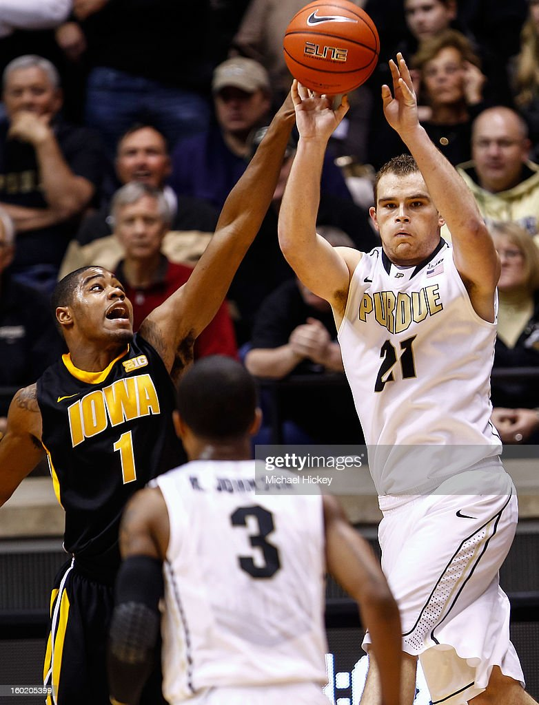 As Melsahn Basabe #1 of the Iowa Hawkeyes defends D.J. Byrd #21 of the Purdue Boilermakers passes the ball off at Mackey Arena on January 27, 2013 in West Lafayette, Indiana. Purdue defeated Iowa 65-62 in overtime.