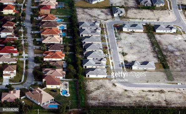 As new home sales and housing starts hit record lows empty house lots are seen next to newly constructed homes in a subdivision on January 30 2009 in...