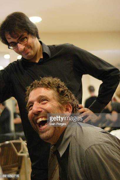 As PalestinianIsraeli pianist Saleem Abboud Ashkar smiles behind him pianist and conductor Asher Fisch laughs during a rehearsal for the 10th...