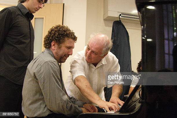 As PalestinianIsraeli pianist Saleem Abboud Ashkar watches Asher Fisch and Daniel Barenboim work together at a piano during a rehearsal for the 10th...