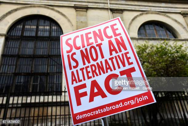 As part of a global movement March for Science protesters march to demonstrate on April 22 2017 in Paris to oppose Trump's rejection of science...