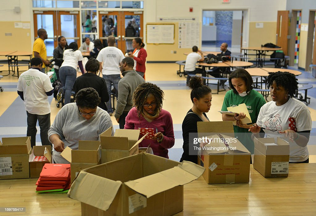 As part of the National Day of Service, volunteers from the region and those coming into DC for the Obama inauguration, inscribe and gift-wrap books for needy DCPS (DC Public School) children at Turner Elementary School on Saturday, January 19, 2012, in Washington, DC.