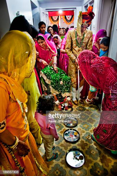 As per the custom bride steps on the 'kumkum' plate to colour her feet with red colour and then the newlywed couple enters the house on February 19...