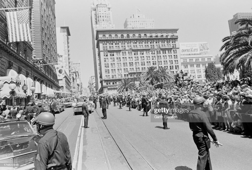 As police stand in the road supporters and protestors press against barricades on both sides of Powell Street as they await for President Nixon's...