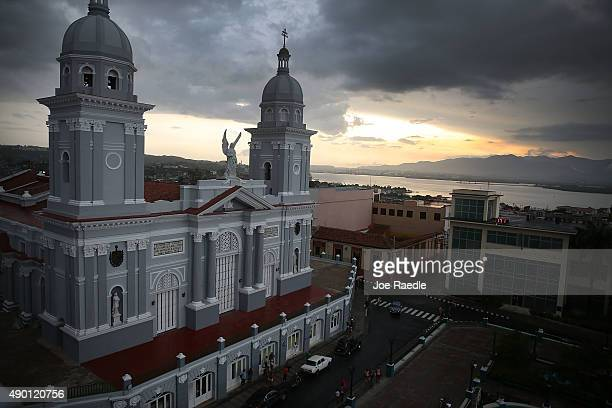 As Pope Francis continues his 10 day trip through the United States after a four day stop in Cuba the sun sets behind the Cathedral of Our Lady of...