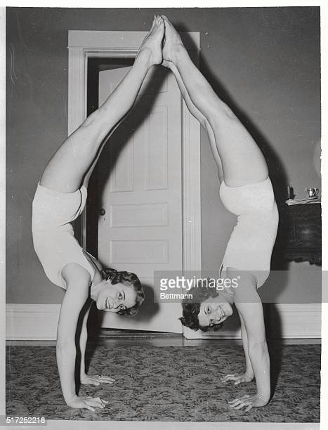 As pretty a pair of parentheses as you'll ever see is formed by these two Chicago gymnast Jackie Racek left and Joyce Racek as they indulge in some...