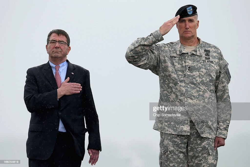 As rain pours out of the sky, Deputy Secretary of Defense <a gi-track='captionPersonalityLinkClicked' href=/galleries/search?phrase=Ashton+Carter&family=editorial&specificpeople=956792 ng-click='$event.stopPropagation()'>Ashton Carter</a> (L) and Army Maj. Gen. William Rappa salute as the remains of Army Spc. Thomas Paige Murach, 22, Meridian, Idaho are transfered at Dover Air Force Base May 7, 2013 in Dover, Delaware. Assigned to the 1st Brigade Combat Team, 1st Armored Division, Murach and four other soliders were killed May 4 when their vehicle hit a roadside bomb during a patrol in the Maiwand District in Kandahar Province, Afghanistan.