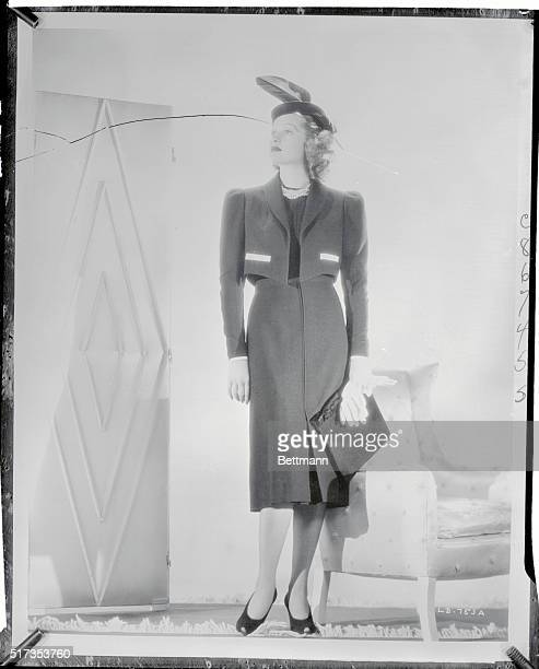 As refreshing as Spring itself are the white pique touches on this longsleeved Bolero ensemble of black sheer wool worn by lovely Lucille Ball RKO...