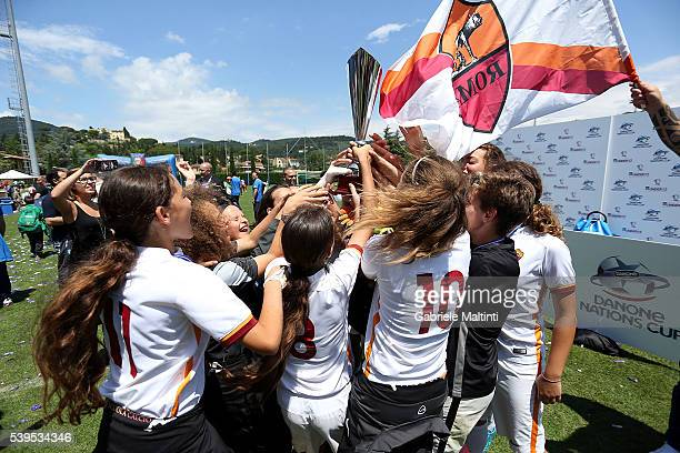 As Roma Women's Under12 celebrates the Danone Cup during the Italian Football Federation 8th Grassroots Festival at Coverciano on June 11 2016 in...