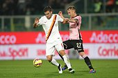 As Roma's Kevin Strootman fights for the ball with Palermo's Luca Rigoni during the Italian Serie A football match Palermo vs AS Roma on January 17...
