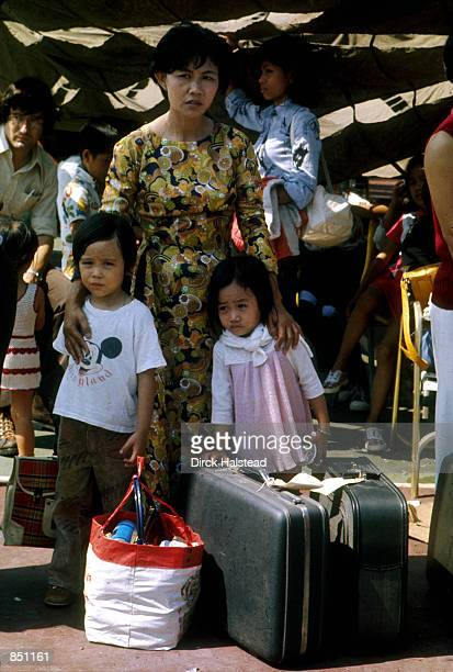 As Saigon falls to the communist rule of North Vietnamese a Vietamese family await evacuation April 1975 in Saigon Vietnam A 25th Anniversary parade...