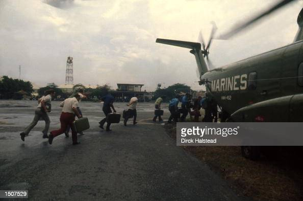 As Saigon falls to the communist rule of North Vietnamese US Marines evacuate Americans and Vietnamese April 1975 at Tan Son Nhut Airbase in South...