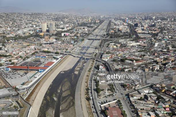 As seen from a US Customs and Border Protection helicopter a drainage canal cuts through Tijuana Mexico near the San Ysidro port of entry on May 11...
