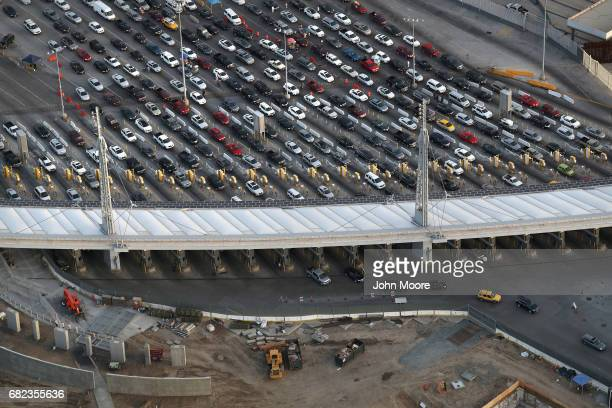 As seen from a US Customs and Border Protection helicopter vehicles line up to enter from Mexico into the United States at the San Ysidro port of...
