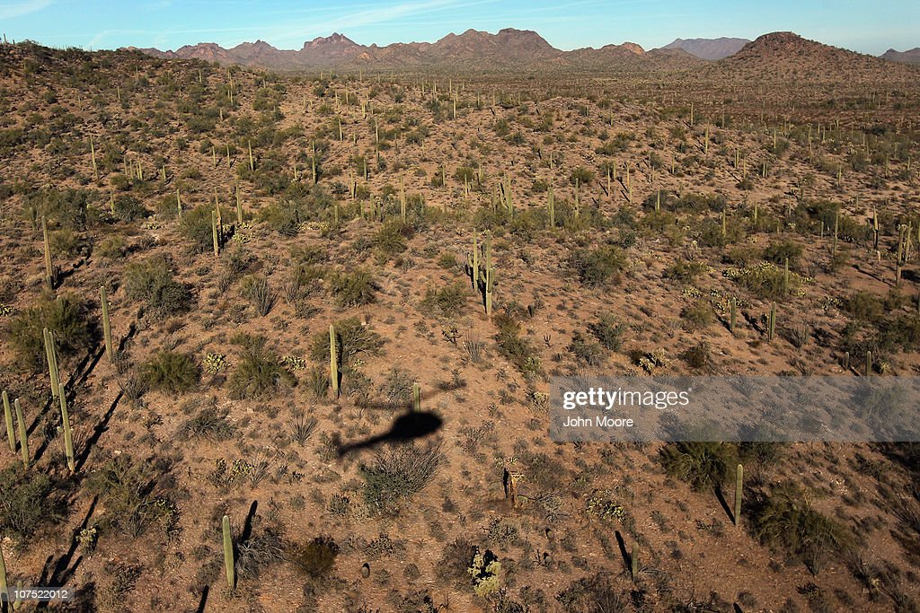 As seen from the air a helicopter from the US Office of Air and Marine searches for drug smugglers moving north through the Sonoran Desert on...