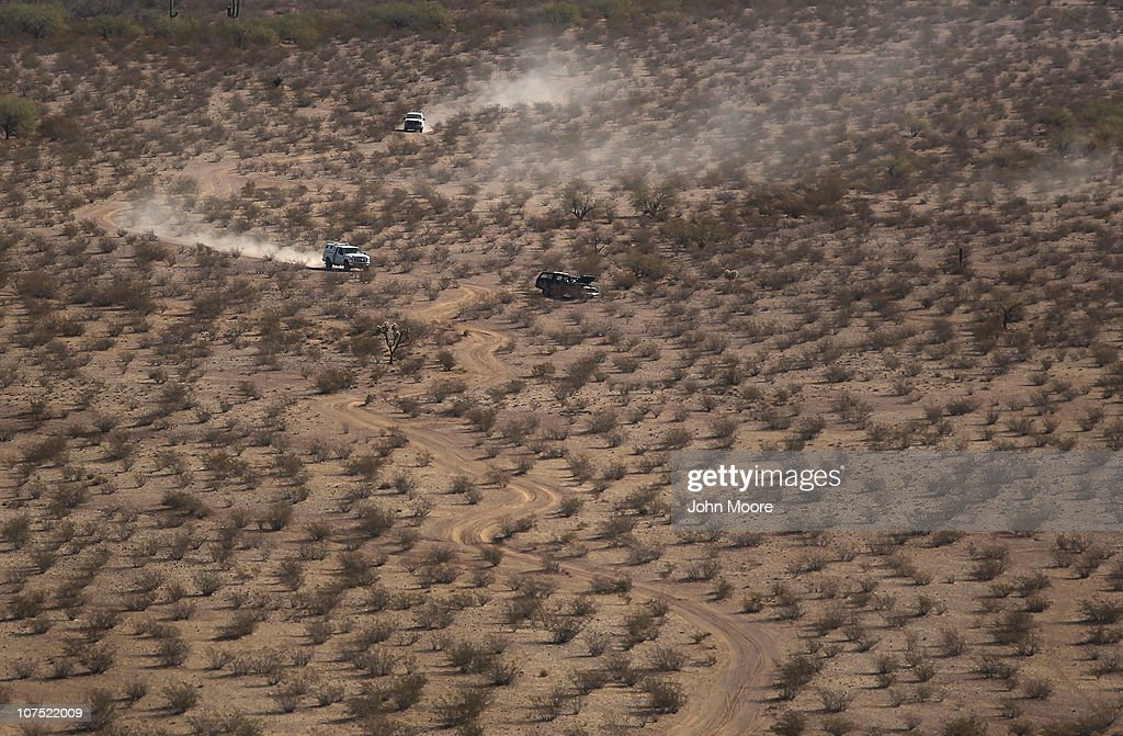 As seen from the air, U.S. Border Patrol agents follow the tire tracks of drug smugglers through the Sonoran Desert on December 9, 2010 in the Tohono O'odham Reservation, Arizona, near the U.S.-Mexico border. The remote area is a favorite spot for smugglers and illegal immigrants to cross into the United States.