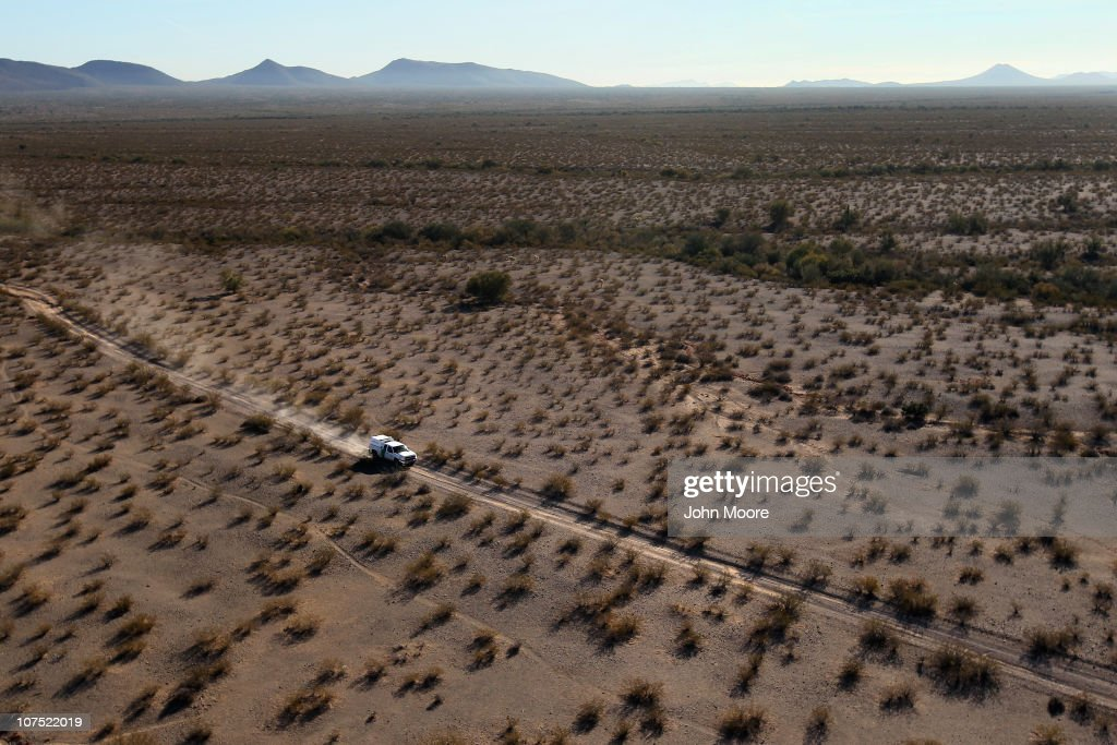 As seen from the air US Border Patrol agents follow the tire tracks of drug smugglers through the vast Sonoran Desert on December 9 2010 in the...