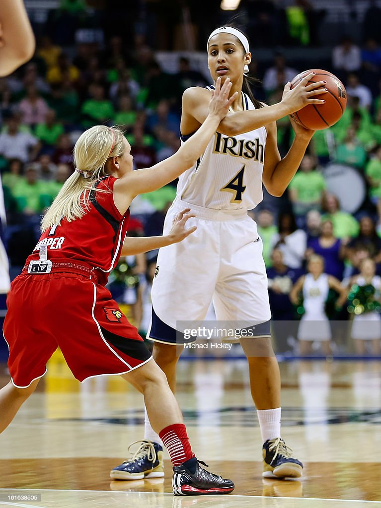 As Shelby Harper #1 of the Louisville Cardinals guards Skylar Diggins #4 of the Notre Dame Fighting Irish holds the ball at Purcel Pavilion on February 11, 2013 in South Bend, Indiana. Notre Dame defeated Louisville 93-64.