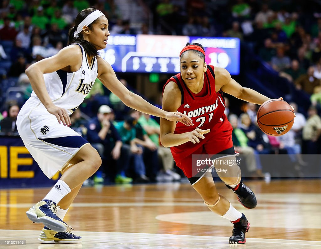 As <a gi-track='captionPersonalityLinkClicked' href=/galleries/search?phrase=Skylar+Diggins&family=editorial&specificpeople=5791961 ng-click='$event.stopPropagation()'>Skylar Diggins</a> #4 of the Notre Dame Fighting Irish guards Bria Smith #21 of the Louisville Cardinals dribbles the ball to the hoop at Purcel Pavilion on February 11, 2013 in South Bend, Indiana. Notre Dame defeated Louisville 93-64.