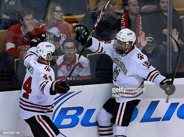 As some BU fans look stunned in the crowd NU's John Stevens right celebrates his first period goal with teammate Dax Lauwers left Northeastern...