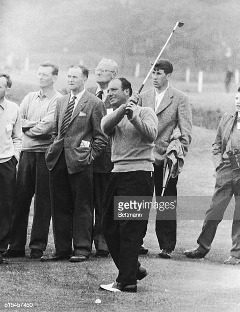As spectators watch intently Argentine golfer Roberto De Vicenzo shows a fluid swing as he drives one toward the pin during his qualifying round in...
