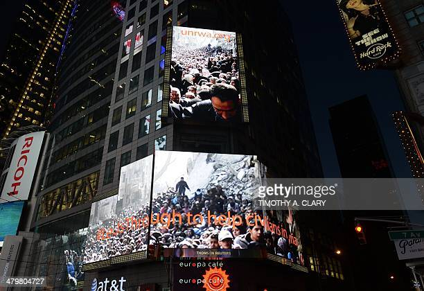 As supporters throng Times Square an image of crowds of Palestinians lining up for UN Relief and Works Agency food parcels which has emerged as an...