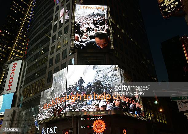 As supporters throng Times Square as an image of crowds of Palestinians lining up for UN Relief and Works Agency food parcels which has emerged as an...
