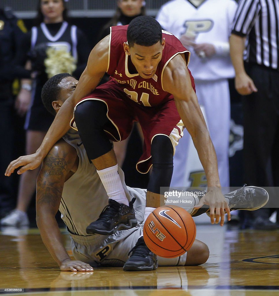 As Terone Johnson #0 of the Purdue Boilermakers falls to the ground Olivier Hanlan #21 of the Boston College Eagles chases down a loose ball at Mackey Arena on December 4, 2013 in West Lafayette, Indiana. Purdue defeated Boston College 88-67.