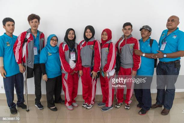as the athlete coach for disability in Banten and Mrs YOYOH as chief of National Para Committee Banten pose with athlete that achieved medal from...