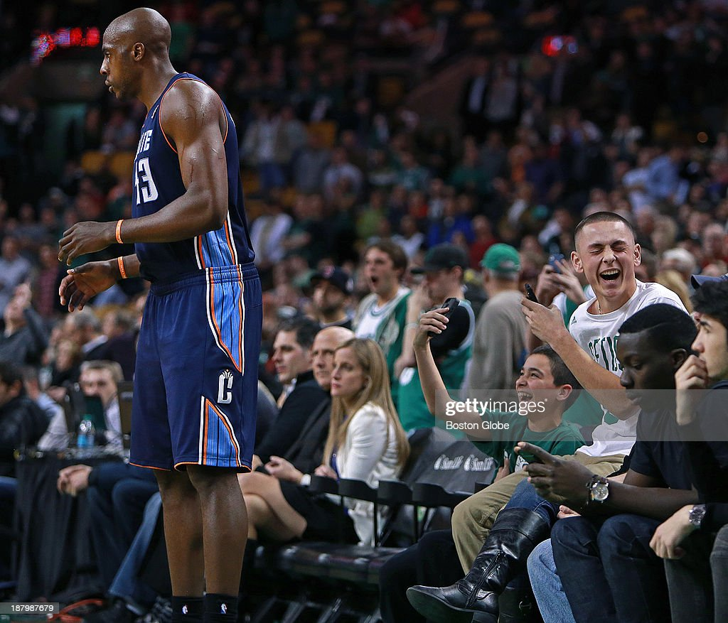 As the Bobcats' Anthony Tolliver prepares to inbound the ball right in front of them, two young front row fans have some fun as they take advantage of his closeness to record the moment with their phones. The Boston Celtics hosted the Charlotte Bobcats in a regular season NBA game at TD Garden.