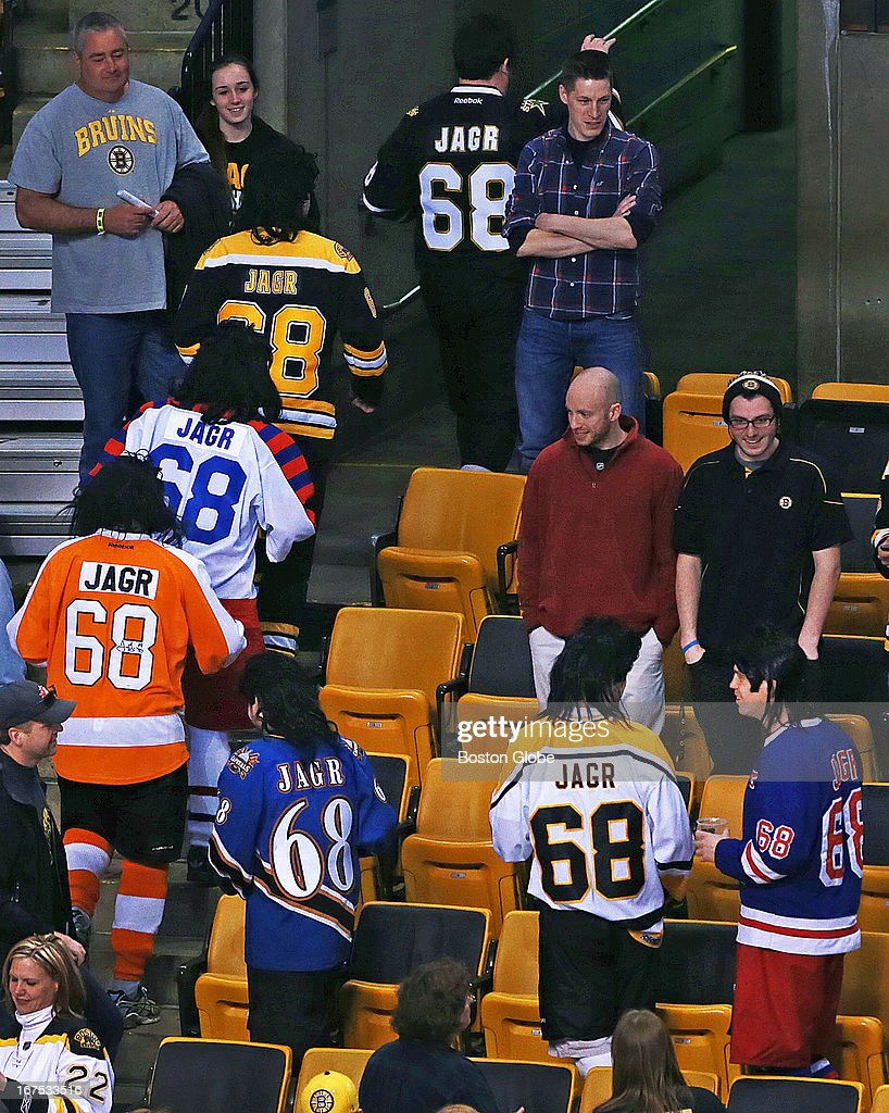 As the Bruins were doing their pre-game warmups, eight fans, all sporting mullet wigs and each wearing a Jaromir Jagr sweater, one from all of the different teams he has played for over his long career, appeared to finally get the attention of the veteran winger on the ice and they smiled and gestured towards him. After they had finally done it, they all walked out together with the various 'Jagr 68''s on their respective backs. The Boston Bruins hosted the Tampa Bay Lightning in a regular season NHL game at the TD Garden.