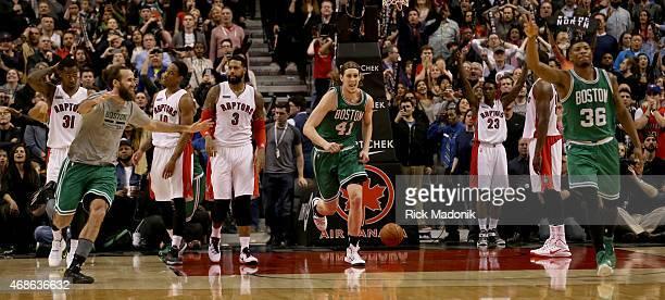 TORONTO APRIL 4 As the Celtics celebrate the Raptors are left a little bit stunned as they lose at the buzzer Toronto Raptors vs Boston Celtics in OT...