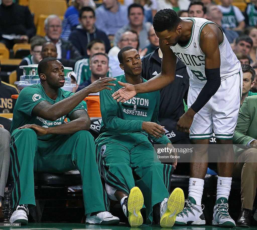 As the Celtics' Jeff Green comes to the bench for the last time this season, he gets a hand from teammates Brandon Bass and Rajon Rondo. The Boston Celtics hosted the Washington Wizards in their final NBA game of the season at the TD Garden on Wednesday, April 16, 2014.
