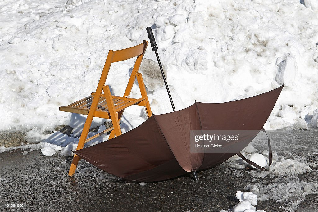 As the city digs out after a blizzard hit New England, an umbrella and chair combo are already saving a parking spot in South Boston, Feb. 10, 2013.