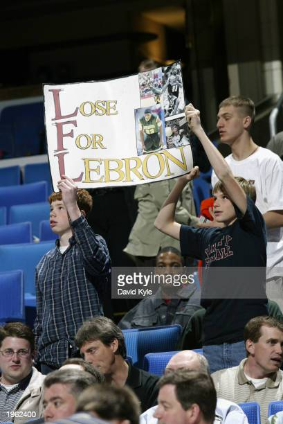 As the Cleveland Cavaliers take on the Toronto Raptors Cleveland fans hold a sign hoping that the Cavaliers will eventually draft LeBron James of the...