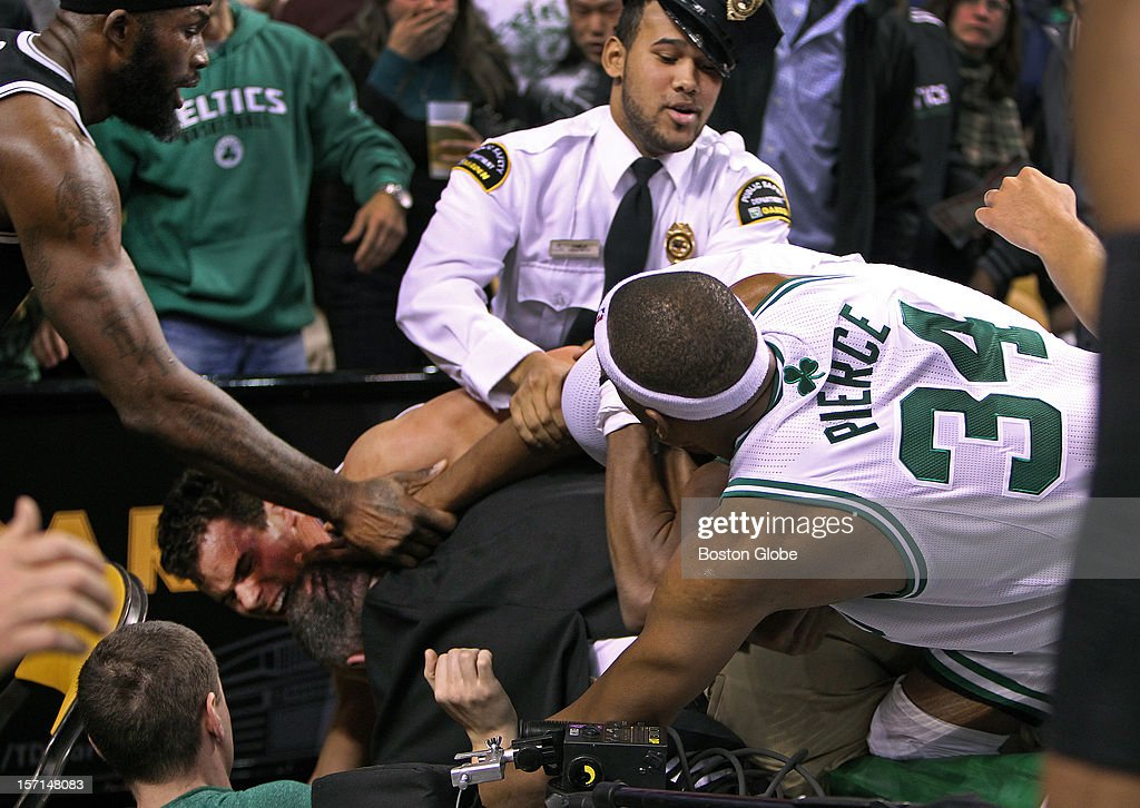 As the fight spilled into the area behind the basket, the Celtics' Rajon Rondo had his jersey pulled over his head hockey style, as he and Paul Pierce battled with the Nets' Kris Humphries, who was battling with Garden security at lower left. The Boston Celtics hosted the Brooklyn Nets in a regular season NBA game at the TD Garden.