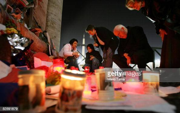 As the midnight hour approaches mourners view a makeshift memorial in St Peter's Square April 5 2005 in Vatican City The body of Pope John Paul II...