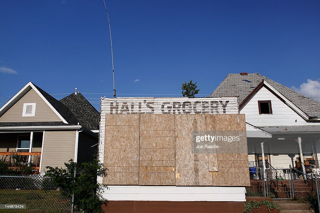 As the one year anniversary of the massive tornado hitting the town approaches a damaged grocery store is seen next to a home that has been rebuilt on May 20, 2012 in Joplin, Missouri. Tuesday will mark the one-year anniversary of the EF-5 tornado that devastated the town. The tornado left behind a path of destruction along with 161 deaths and hundreds of injuries, but one year later there are signs that the town is beginning to recover.