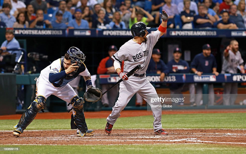 As the pitch gets by Rays catcher Jose Lobaton, the Red Sox Shane Victorino signals for Xander Bogaerts to score from third, which he did, to tie the score at 1-1 in the 7th inning. The Boston Red Sox visited the Tampa Bay Rays in Game Four of the ALDS baseball playoffs at Tropicana Field.