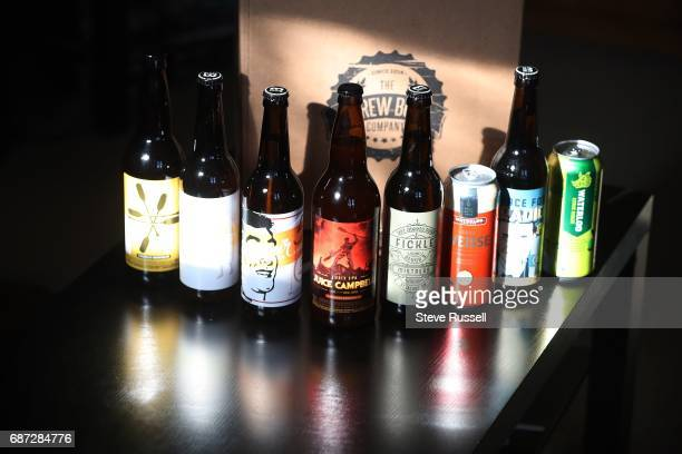 TORONTO ON MAY 14 as the Shannon Rooney opens her box of beer at home that she recieved through a service called Brew Box Craft breweries not able to...