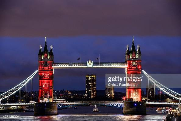 As the sun sets Tower Bridge is lit up in a succession of blue white and red representing the French flag on November 14 2015 in London England The...