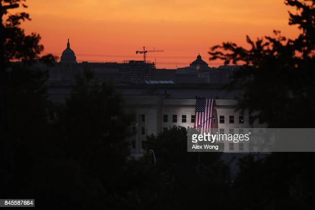 As the US Capitol is seen in the background an American flag is unfurled on the side of the Pentagon to commemorate the anniversary of the 9/11...