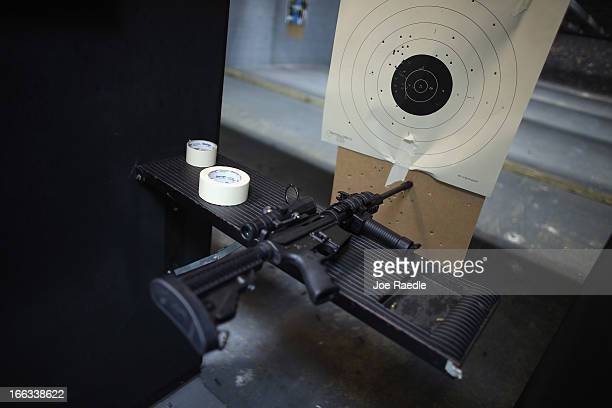As the US Senate takes up gun legislation in Washington DC an AR15 semiautomatic rifle is seen next to a target in the indoor gun range at the...