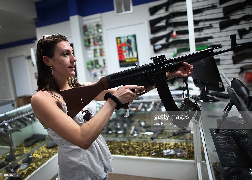 As the U.S. Senate takes up gun legislation in Washington, DC , Cristiana Verro looks at guns on sale at the National Armory gun store on April 11, 2013 in Pompano Beach, Florida. The Senate voted 68-31 to begin debate on a bill that would significantly expand background checks for gun sales.
