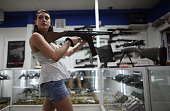 As the US Senate takes up gun legislation in Washington DC Cristiana Verro browses for guns on sale at the National Armory gun store on April 11 2013...