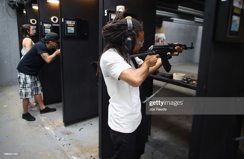 As the U.S. Senate takes up gun legislation in Washington, DC , Dillion Dawkins shoots his weapon on the indoor gun range at the National Armory gun store on April 11, 2013 in Pompano Beach, Florida. The Senate voted 68-31 to begin debate on a bill that would significantly expand background checks for gun sales.