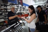 As the US Senate takes up gun legislation in Washington DC Dr Gary Lampert a coowner of the National Armory gun store helps Cristiana Verro consider...