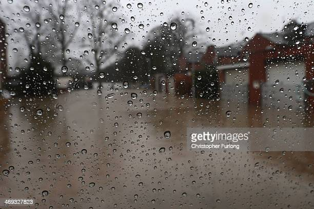As the weather continues to deterioate rain drips down a window overlooking a flooded street on February 14 2014 in Worcester United Kingdom Flood...
