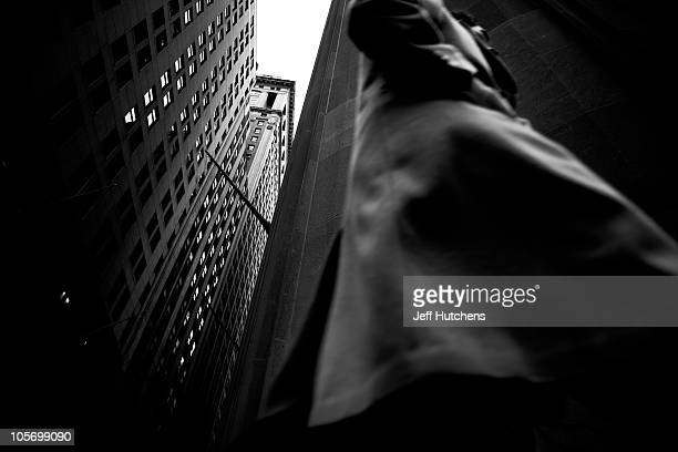 As the world economy struggles to overcome a recession a man leaves work outside the New York Stock Exchange in the heart of New York's financial...